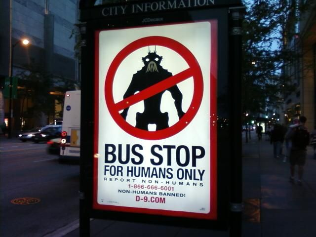 district 9 viral poster invades chicago bus stop