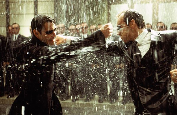 http://www.collider.com/uploads/imageGallery/Matrix_The/the_matrix_movie_image_keanu_reeves_as_neo_fighting_the_matrix_movie_image_hugo_weaving_agent_smith.jpg
