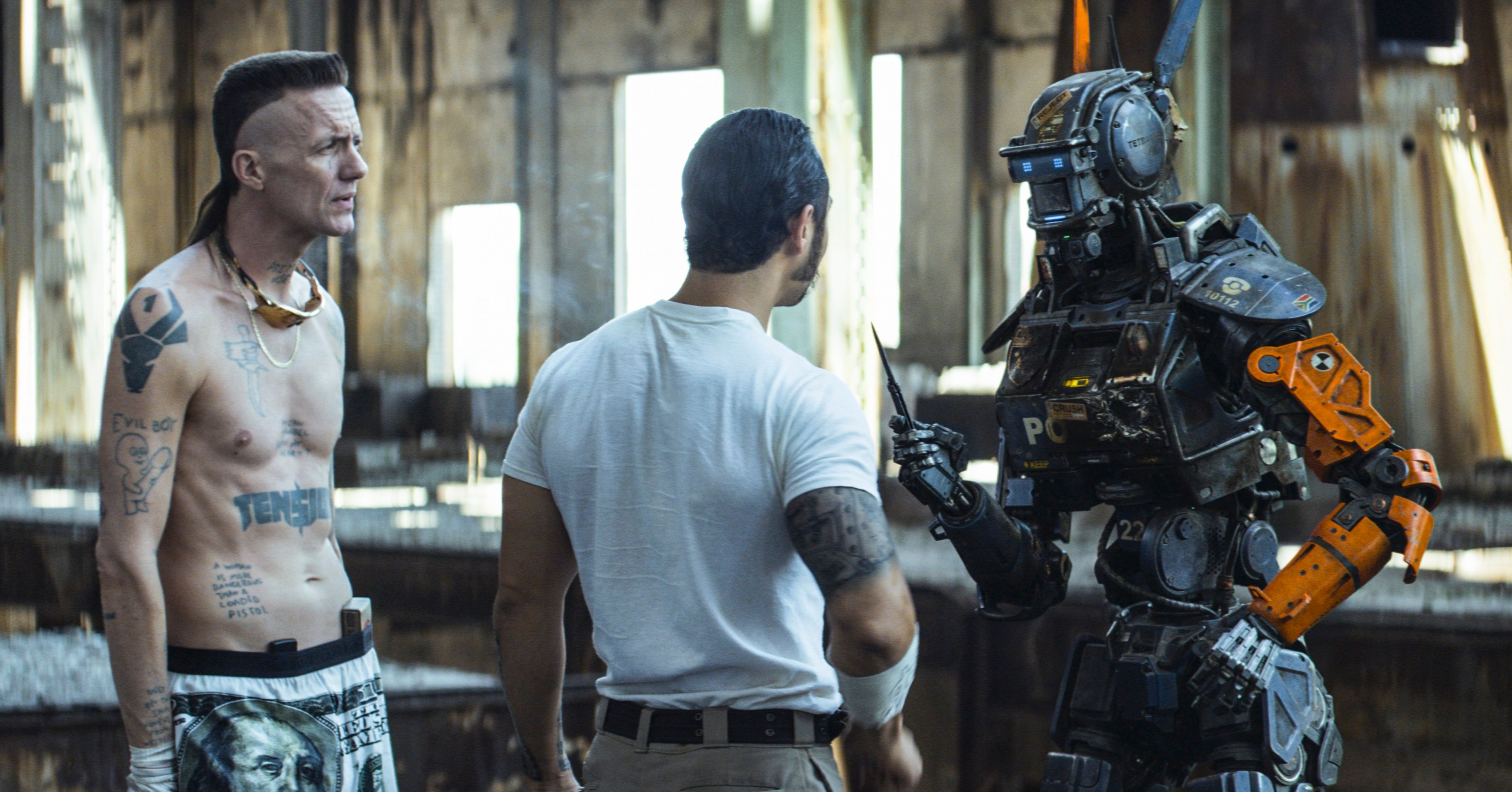 New Chappie Images Highlight Hugh Jackman S Mullet Collider