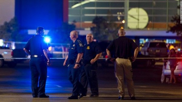 Police officers responding to Lafayette, LA movie theater shooting.