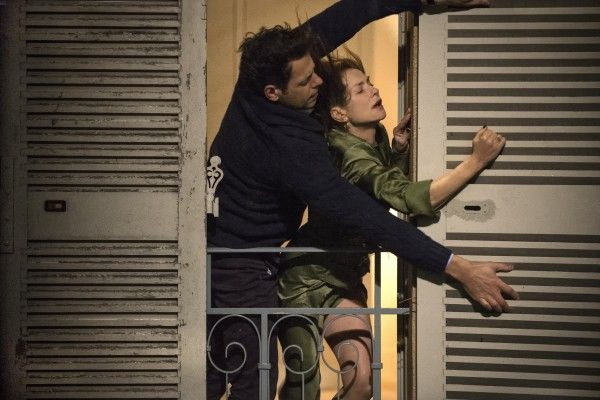 isabelle-huppert-in-elle-closing-her-shutters-in-storm-with-help-of-neighbor