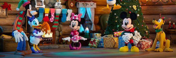 Mickey Mouse and friends gather in front of a Christmas tree.