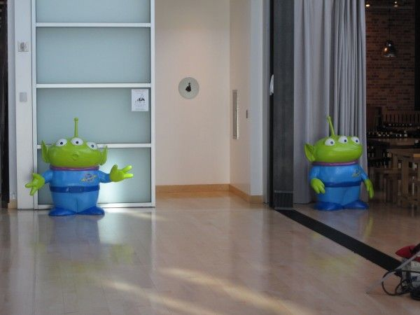 "The ""Toy Story"" aliens welcome you to the restroom."